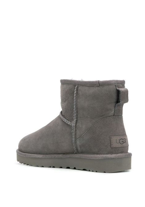 Grey leather ankle boots featuring a shearling lining UGG |  | 1016222-CLASSIC MINI IIGREY