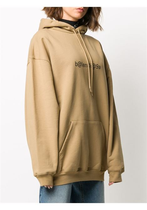 Oat and black cotton Balenciaga logo print hoodie from featuring drawstring hood BALENCIAGA |  | 578135-TIV519605