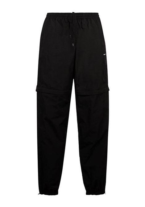 Pantalone in polyammide e nylon nero con zip trasformabile in bermuda BALENCIAGA | Pantaloni | 621435-TDO131000