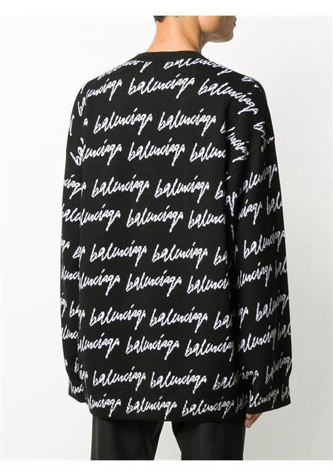 maglione oversize nero in lana con lettering logo Balenciaga all over BALENCIAGA | Maglieria | 625984-T31841070