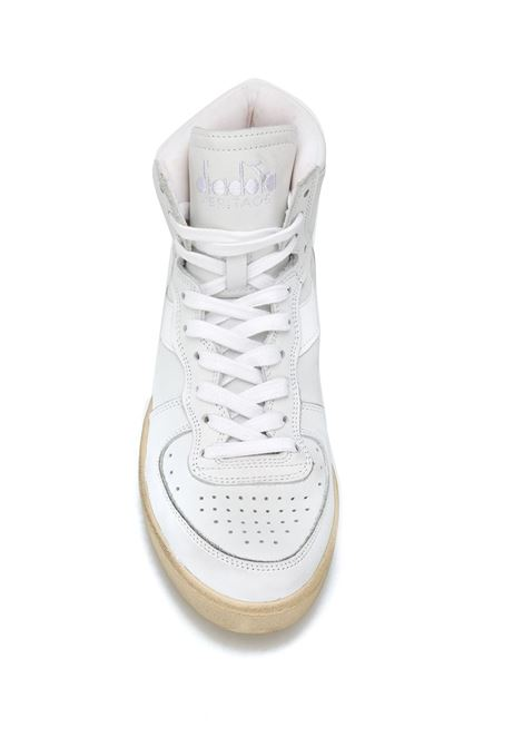 White leather lace-up high-top sneakers featuring a round toe DIADORA |  | 158569-MI BASKET USEDC0657