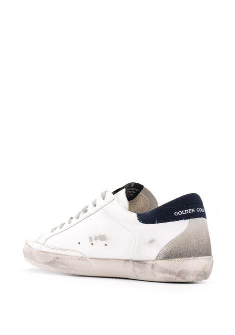 Sneaker Superstar in pelle bianca con stella nera sui lati, GGDB | Sneakers | GMF00102-F00060910341