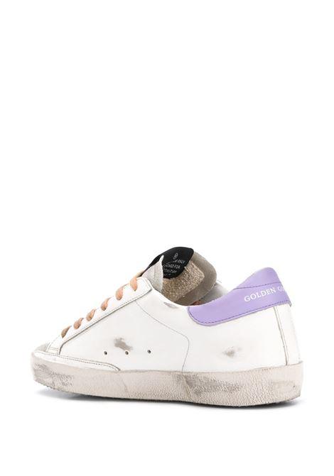 sneakers Superstar in pelle bianca con stella laterale glitterata, lacci arancio e particolare sul tallone lilla GGDB | Sneakers | GWF00101-F00021310242