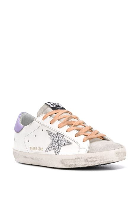 white leather Superstar sneakers with front suede detail, side silver glitter star, orange fastening and lilac detail on the back GGDB |  | GWF00101-F00021310242