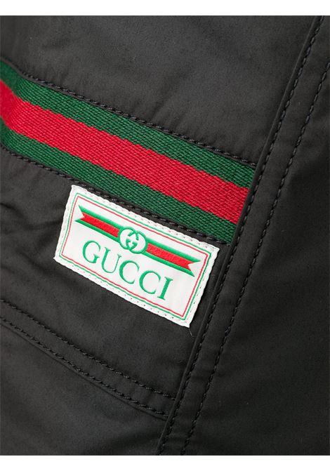 pantaloni sportivi neri in cotone con dettaglio Web Gucci GUCCI | Pantaloni | 604171-XDBCH1043