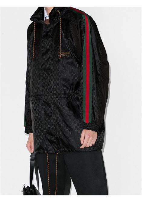 black long nylon parka-jacket with Gucci print all over  GUCCI |  | 618891-ZAENY1000