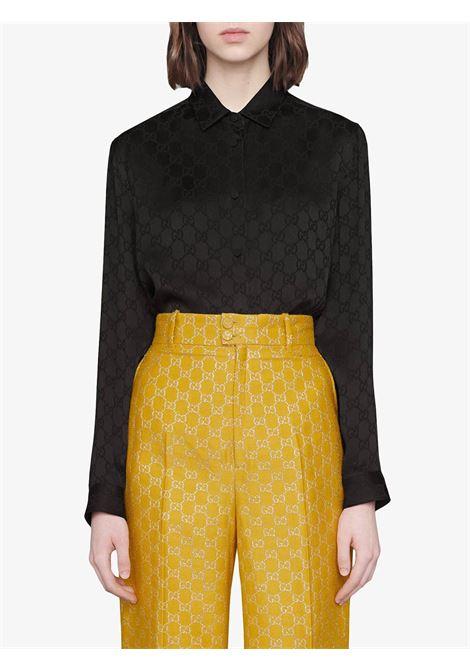 camicia di seta nera con stampa Gucci Supreme all over GUCCI | Camicie | 627773-ZAEJF1000