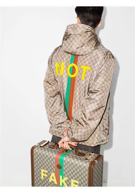 Cream nylon Fake/Not jacket  featuring Gucci Supreme all over print GUCCI |  | 636391-ZAKKX7294