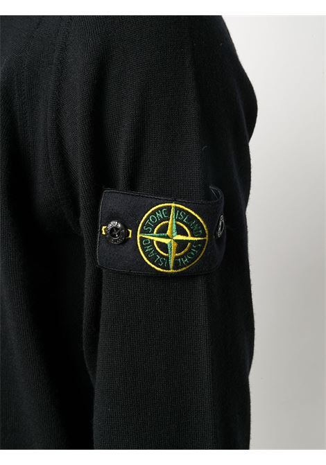Maglia a costine in lana nera con girocollo STONE ISLAND | Maglieria | 7315526C4V0029