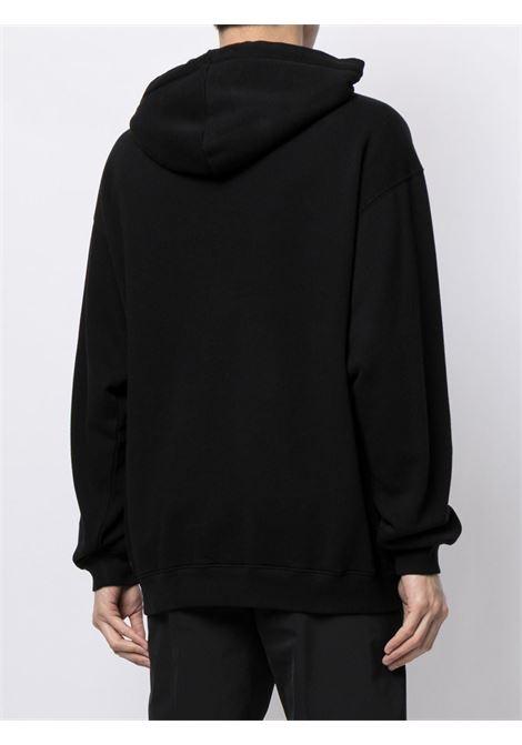 Felpa nera in cotone con cappuccio e logo Balenciaga pixellato bianco BALENCIAGA | Felpe | 600583-TKVI81070
