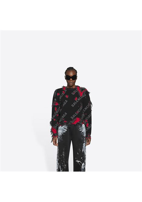 Black wool sweater with red tattered details and Balenciaga logo BALENCIAGA |  | 662528-T16035963