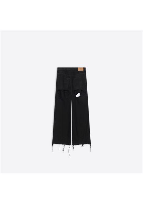 jeans nero in denim giapponese biologico ripped all over BALENCIAGA | Pantaloni | 664265-TJW582470