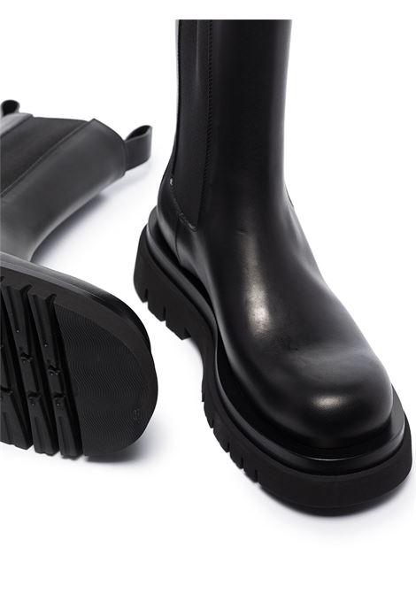 Stivaletti Lug 55mm in pelle di vitello nero BOTTEGA VENETA | Stivali | 592045-VIFH01000