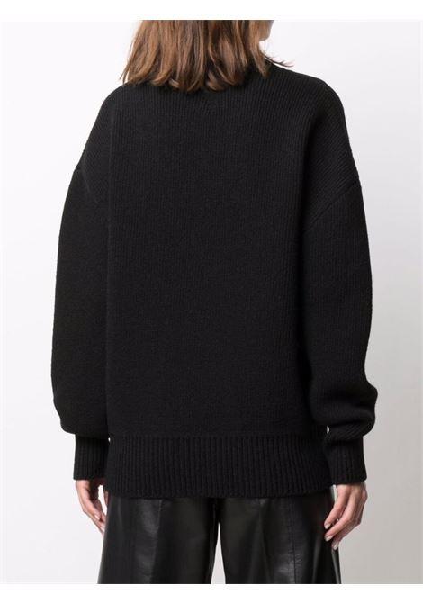 Maglione girocollo in lana nera con decorazione in ottone BOTTEGA VENETA | Maglieria | 665073-V0Z401000
