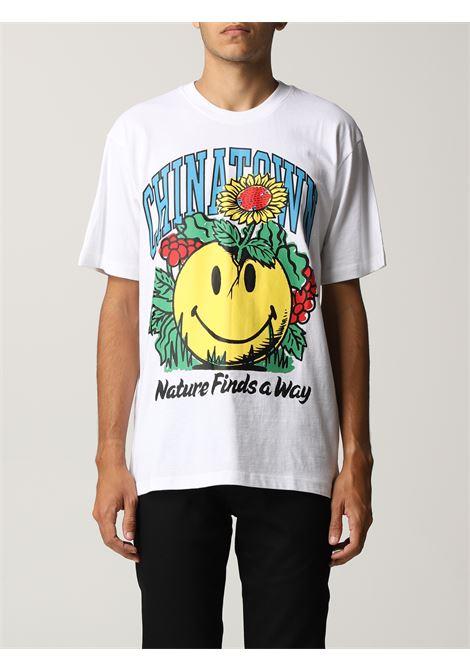 T-shirt in cotone con stampa Smiley Planter bianca e multicolore CHINATOWN MARKET   T-shirt   1990536-SMILEY PLANTERWHITE