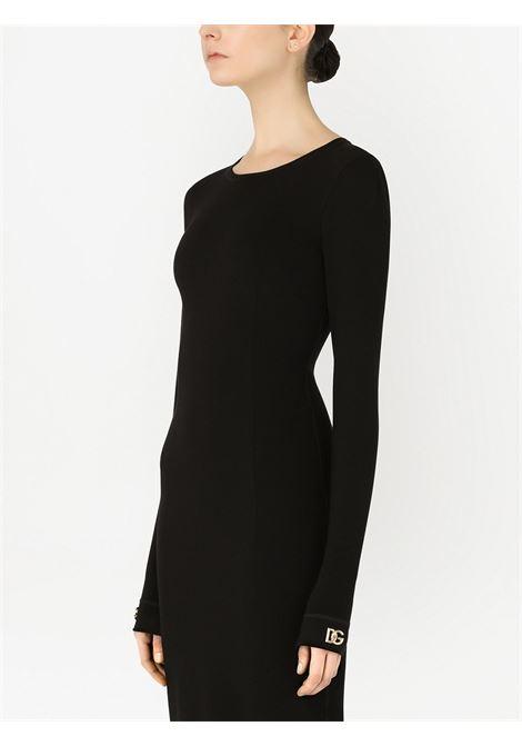 Abito nero aderente con polsini con logo Dolce & Gabbana dorato DOLCE & GABBANA | Abiti | F6R6MT-FUGKGN0000