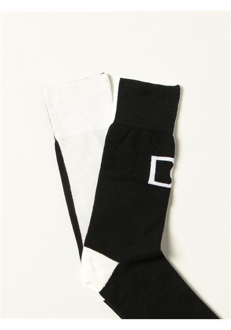 Calzini in cotone bicolore bianco e nero con logo Dolce & Gabbana DOLCE & GABBANA | Calze | GXG84T-JACKQS9000