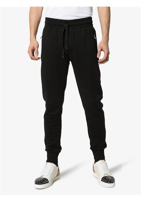 pantalone nero in jersey di cotone e felpa con coulisse in vita DOLCE & GABBANA | Pantaloni | GYWDAT-FU7DUN0000