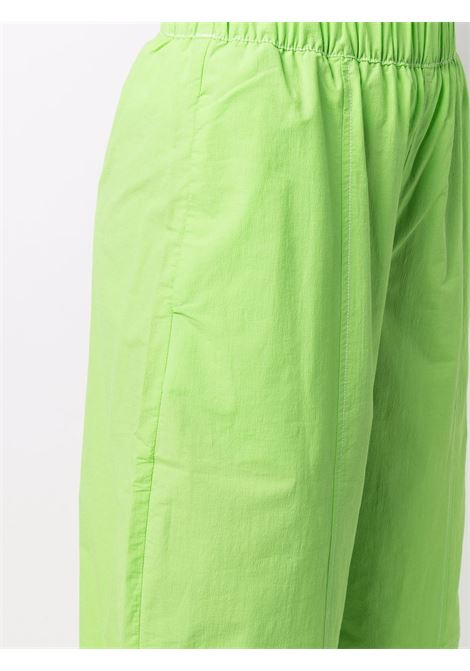 Pantaloni a gamba ampia in cotone biologico color verde flash GANNI | Pantaloni | F6205783