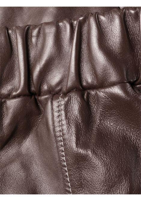 pantalone in pelle organica marrone con gamba a palloncino GANNI | Pantaloni | F6293897