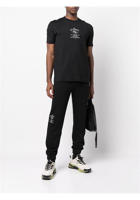 Pantaloni sportivi neri in cotone con logo Givenchy laterale GIVENCHY | Pantaloni | BM50Y63Y6V001