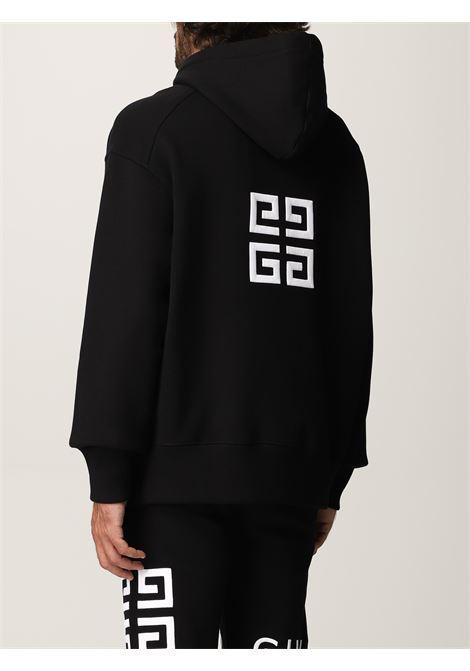 Felpa nera con cappuccio in cotone con logo Givenchy bianco sul petto GIVENCHY   Felpe   BMJ0C93Y69001