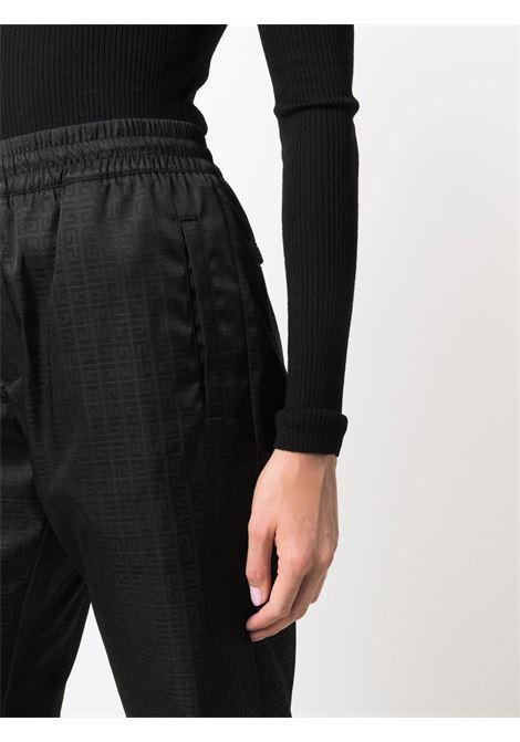 Pantaloni neri a vita elasticizzata con monogramma 4G all over GIVENCHY | Pantaloni | BW50R513PK001