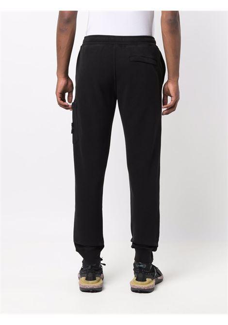 Black cotton track pants featuring Stone Island logo patch  STONE ISLAND |  | 751564520V0029
