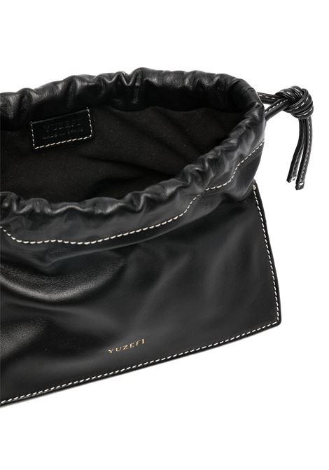 Black leather Mini Bom crossbody bag featuring gold chain top handle YUZEFI |  | MINI BOM-YUZICO-HB-MB00