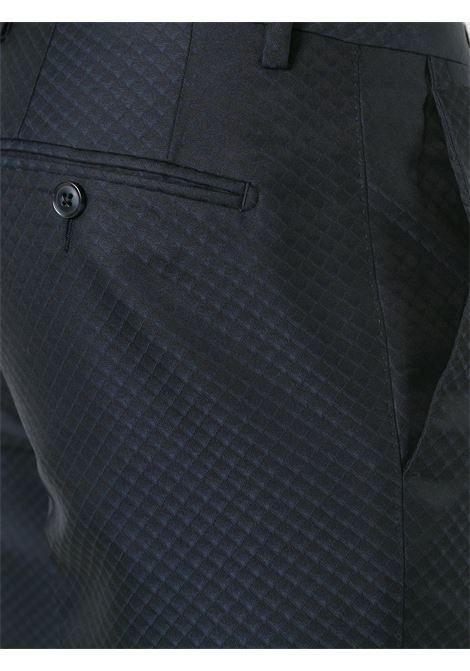 smoking due pezzi blu scuro in misto lana vergine DOLCE & GABBANA | Abiti | G17AMT-FJ3C7B0665