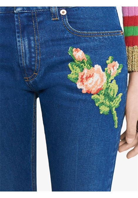 Jeans regular fit con applicazione di fiore e tigre GUCCI | Pantaloni | 449577-XR5034205