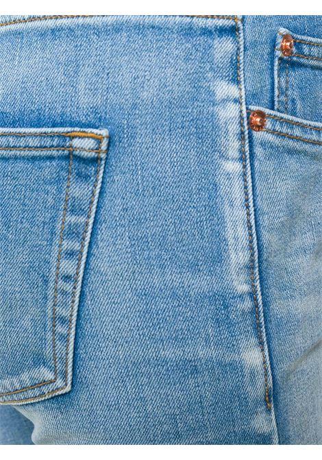 jeans skinny effetto consumato in misto cotone blu BALENCIAGA | Pantaloni | 493467-TXE094065