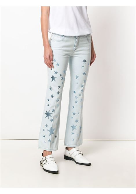 jeans skinny 5 tasche azzurro con applicazione di stelle glitterate all over STELLA MC CARTNEY | Pantaloni | 475508-SKH054300