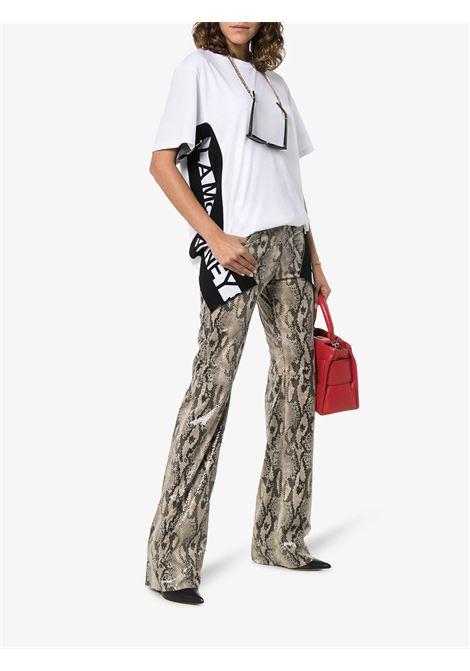 t.shirt bianca oversize con maniche larghe e bande logate nere laterali STELLA MC CARTNEY | Maglieria Moda | 555571-SMW269000