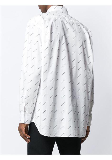 camicia bianca in cotone con logo Balenciaga nero all over BALENCIAGA | Camicie | 534333-TBL969040