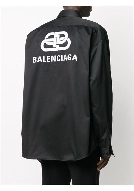 camicia oversize nera a doppia manica con logo fronte / retro BALENCIAGA | Camicie | 603106-TGQ071000