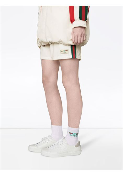 calzino di spugna bianco con logo Gucci GUCCI | Calze | 604038-4GA259200