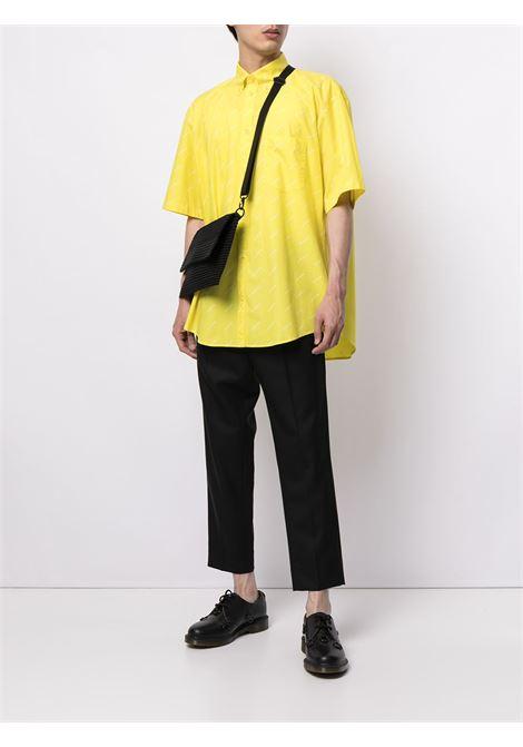 Camicia oversize in popeline di cotone giallo con logo all over Balenciaga BALENCIAGA | Camicie | 534332-TBL967201