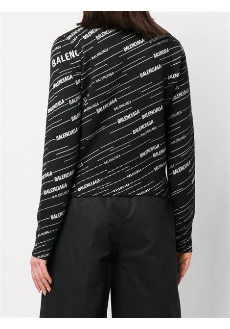 cardigan nero e bianco  lana con logo Balenciaga all over BALENCIAGA | Cardigan | 555294-T15241070
