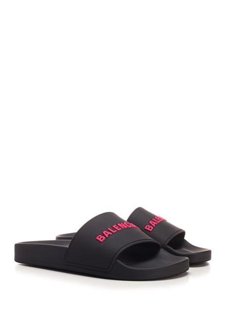 Black polyurethane slipper with fuchsia Balenciaga logo lettering BALENCIAGA |  | 565547-W1S801055