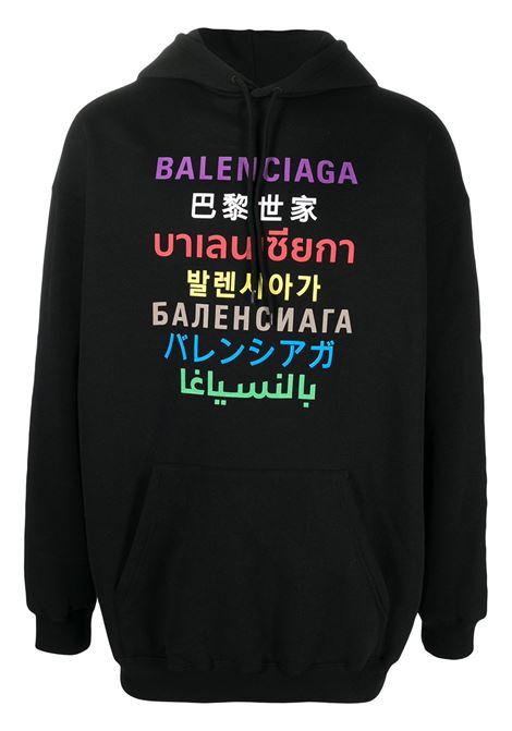 Felpa con cappuccio in cotone nero con stampa logo Balenciaga multicolore e multilingua sul davanti BALENCIAGA | Felpe | 570811-TJVI6271