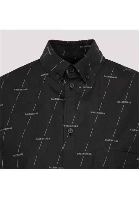 Long oversized shirt in cotton poplin with all-over Balenciaga logo, black button closure and classic collar BALENCIAGA |  | 576677-TJLF31269