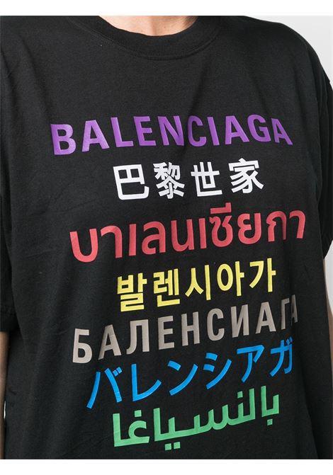 T-shirt in cotone nero con stampa del logo Balenciaga multicolore e multilingue BALENCIAGA | T-shirt | 612965-TJVI32771