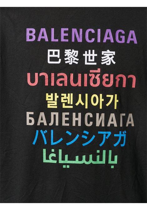 T-shirt nera in cotone con stampa multicolore e multilingua del logo Baenciaga BALENCIAGA | T-shirt | 612966-TJVI32771