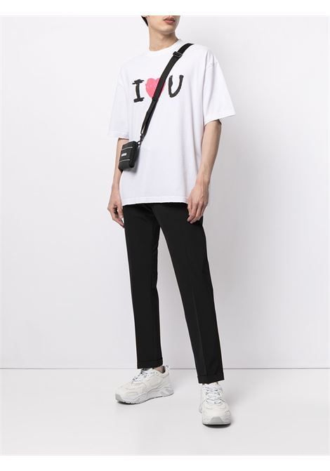 t-shirt a maniche corte in cotone bianco con stampa grafica I  BALENCIAGA | T-shirt | 612966-TJVL59040