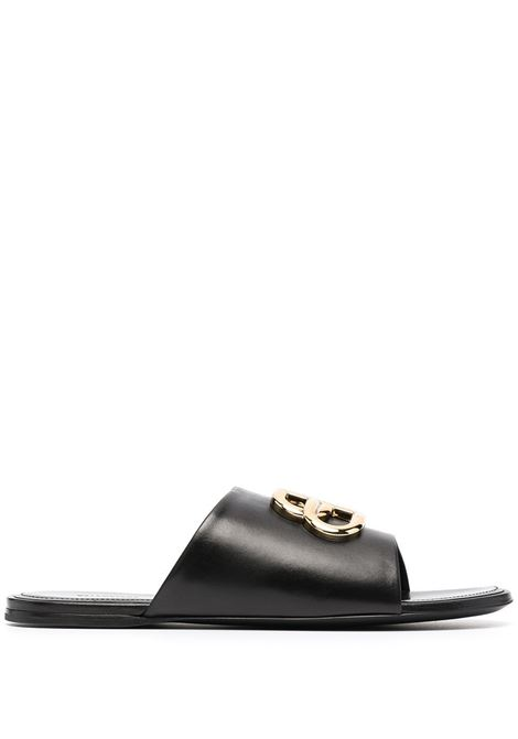 Black slipper in goatskin with Balenciaga logo in golden metal BALENCIAGA |  | 630014-WA8F91088