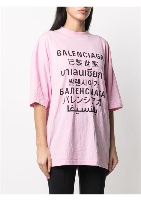 T-shirt in cotone rosa con stampa nera logata Balenciaga multilingua BALENCIAGA | T-shirt | 641532-TJVI31401