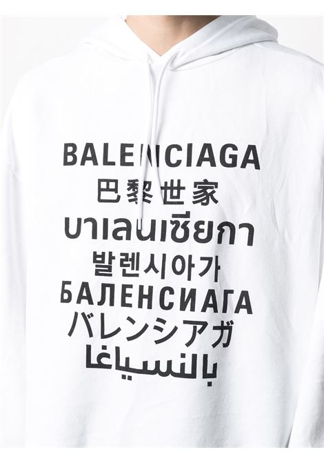 Felpa con cappuccio in cotone bianco con stampa logo Balenciaga multilingue nera BALENCIAGA | Felpe | 641679-TJVI69040