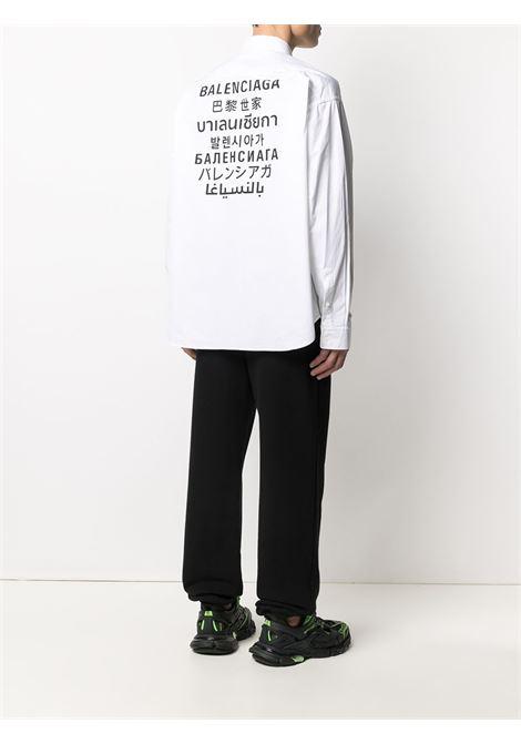 White cotton Languages logo-print button-down shirt featuring black Balenciaga logo print to the rear BALENCIAGA |  | 647357-TYB189000