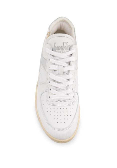Sneaker Basket Row in pelle bianca con perforazioni decorative DIADORA | Sneakers | 176282-MI BASKET ROW CUTC8450